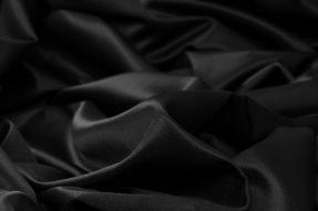 Satin i svart, flamskyddad
